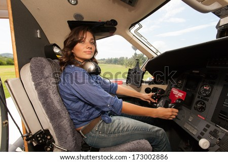 The young beautifu women is a pilot the small plane - stock photo