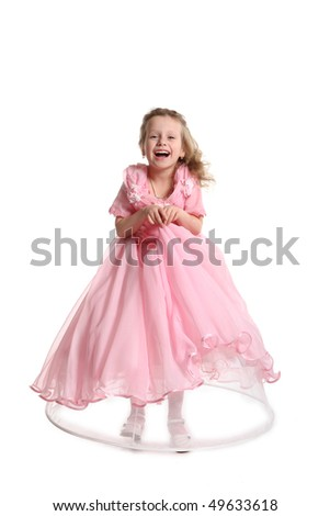 The young beautiful girl in an evening pink dress of princess - stock photo