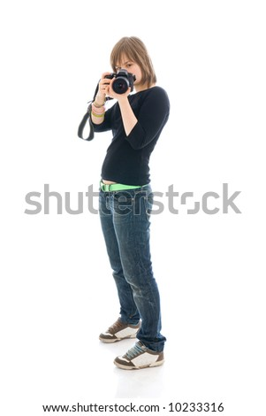 The young beautiful girl with the camera isolated on a white background