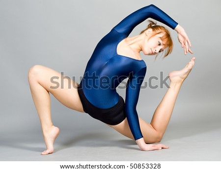 The young beautiful gymnast on training. - stock photo