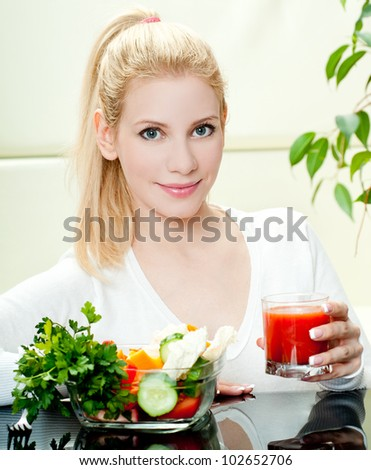 The young beautiful woman with the fresh vegetables - stock photo
