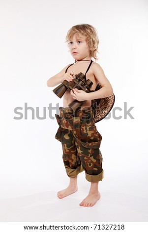 The young Boy holds the field-glass in hands - stock photo