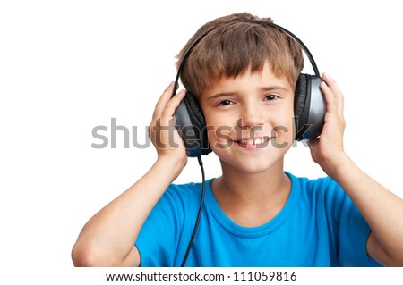 The young boy is smiling and listening to music