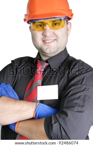 The young builder in a building helmet and goggles on the isolated white background