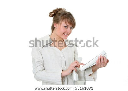 The young business woman dials number on phone with a smile, isolated on a white background