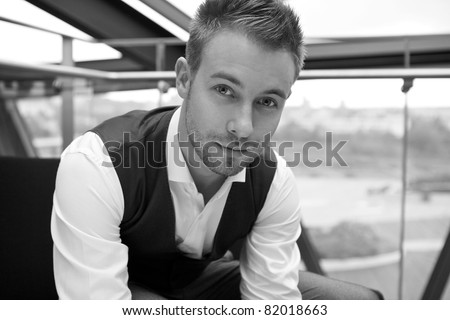 The young businessman in the workplace. Black-white photo. - stock photo