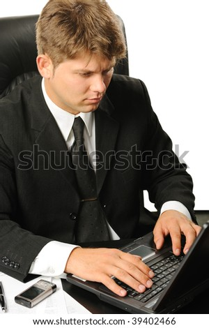 The young businessman on a workplace. It is isolated on a white background - stock photo