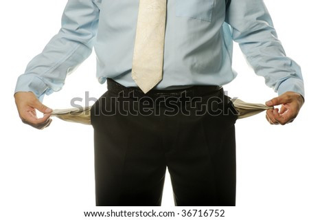 The young businessman with empty pockets - stock photo