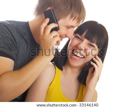 The young couple call by a mobile phone - stock photo