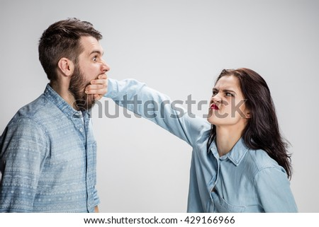 The young couple with different emotions during conflict - stock photo