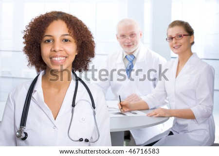 The young female doctor and its colleagues - stock photo