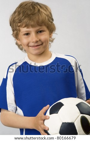 The young football player with  ball in hands