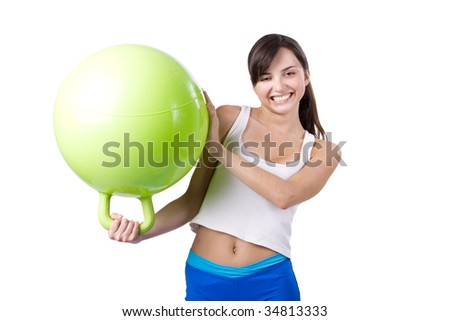 The young girl engaged in fitness on a white background
