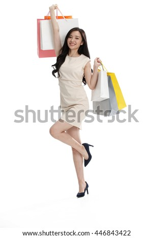 The young girl has a shopping bag.