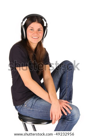 The young girl in earphones smiles