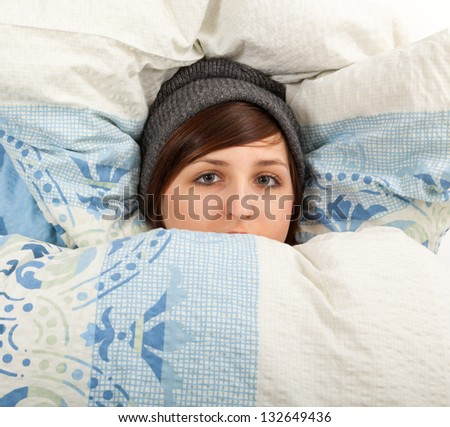 The young girl is lying sick in bed - stock photo
