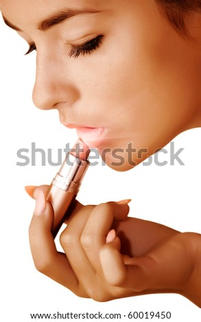 The young girl paints lips - stock photo