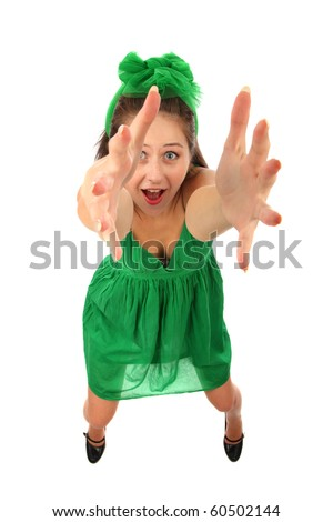 The young girl pulls hands upwards is isolated on a white background