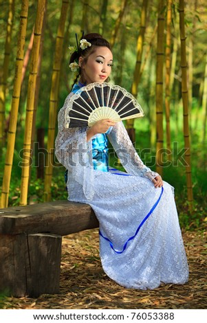 The young girl - the Japanese dressed in a kimono, is on the nature - stock photo