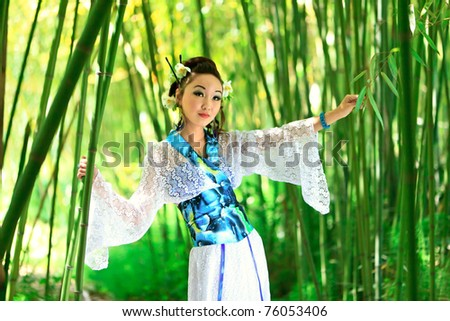 The young girl - the Japanese dressed in a kimono, is on the nature