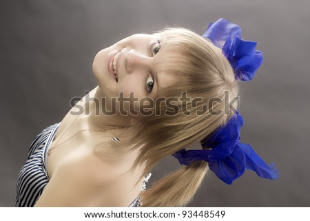 The young girl with dark blue bows looks upwards - stock photo