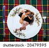 The young girl with underwear lies on a kitchen plate - stock photo