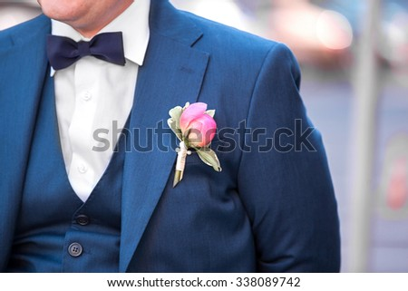 the young groom in the wedding day. the blue bow tie on the groom - stock photo