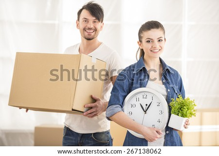 The young happy couple. Moving, purchase of new habitation. - stock photo