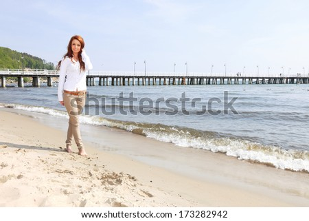 The young happy woman on a beach sea and sky vacation - stock photo