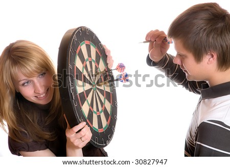 The young man and girl play a darts on white background - stock photo