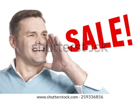 The young man announces declares: Sale! - stock photo