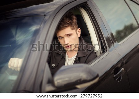 The young man behind the wheel,  traveling - stock photo