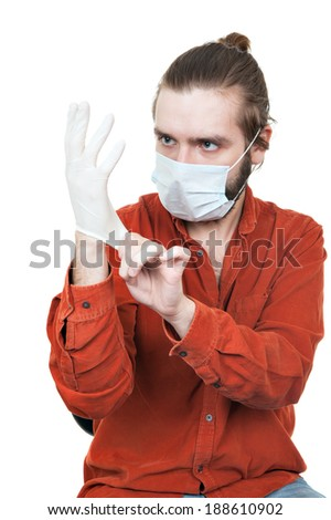 the young man dressing a medical rubber glove - stock photo