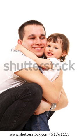 The young man embraces the kid and smiles