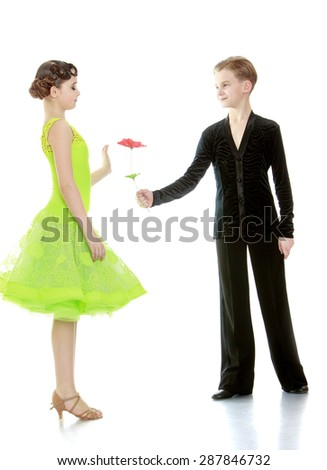The young man gives a flower to a charming young girl-isolated on white background - stock photo