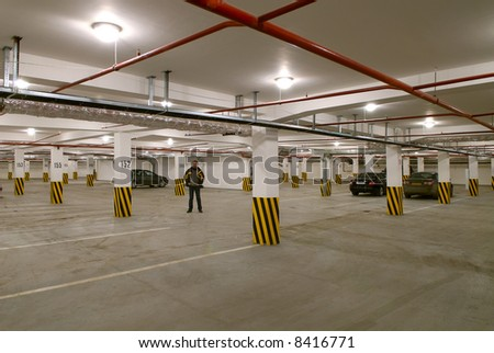 The young man going on a underground parking - stock photo