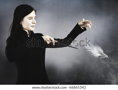 The young man has recite an incantation - stock photo