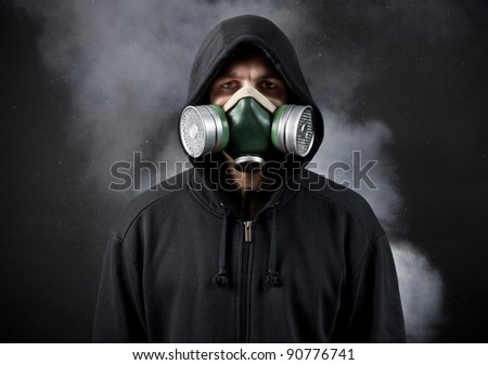The young man in a hood and in a respirator - stock photo