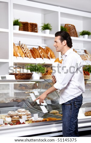 The young man points a finger at a product which wishes to buy - stock photo