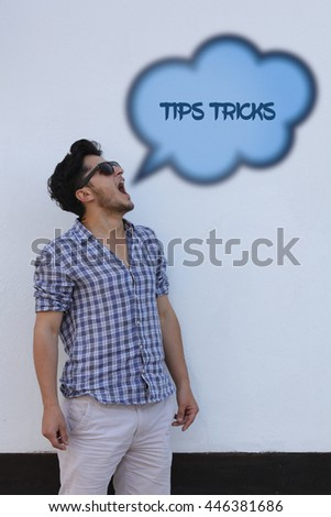 The young man says in the speech bubble from his mouth Tips Tricks. - stock photo