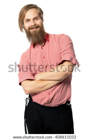 the young man with a beard of the European appearance smiles on a white background in a red shirt and black trousers with braces - stock photo