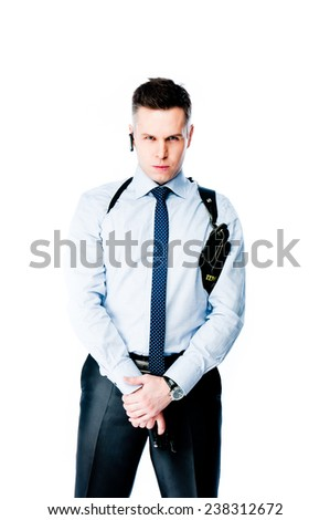 The young man with a pistol - stock photo