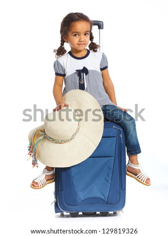 The young mulatto traveler girl with hat and a suitcase. Isolated over white background. Vertical view - stock photo