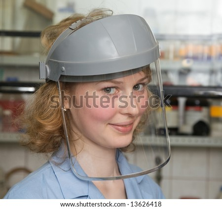 The young nice smiling woman-scientist in protecting mask - stock photo