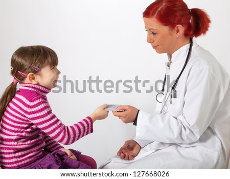 The young pediatrician get a health insurance card - stock photo