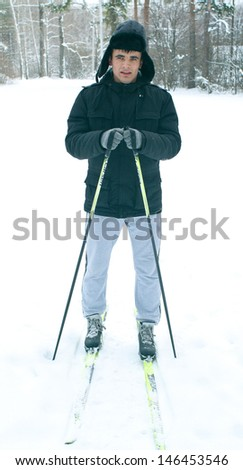 The young skier against winter landscape - stock photo
