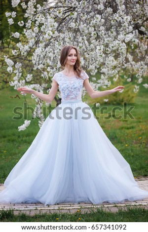 The Young Slender Bride In A Fashionable Wedding Dress With Blue Shade Brides