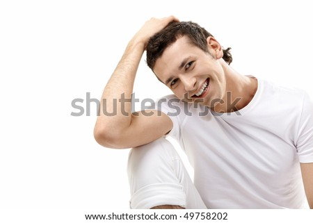 The young smiling man on a white background - stock photo