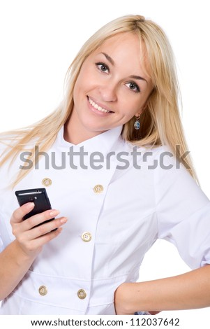 The young smiling nurse with mobile phone(isolated on white background) - stock photo