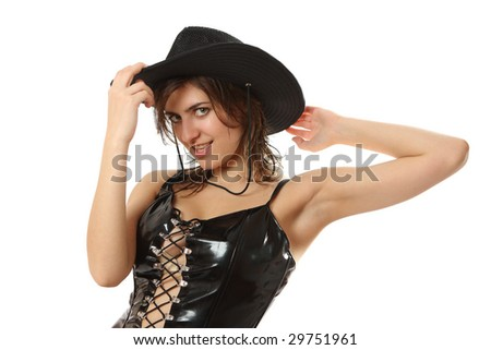 The young woman in a short black leather dress in a hat - stock photo